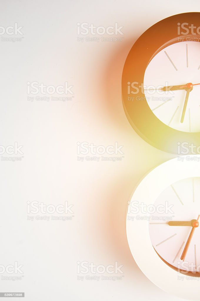 Black and white clock isolated on a white background stock photo