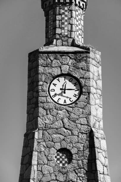 black and white clock tower in daytona beach florida fl - daytona 500 stock photos and pictures