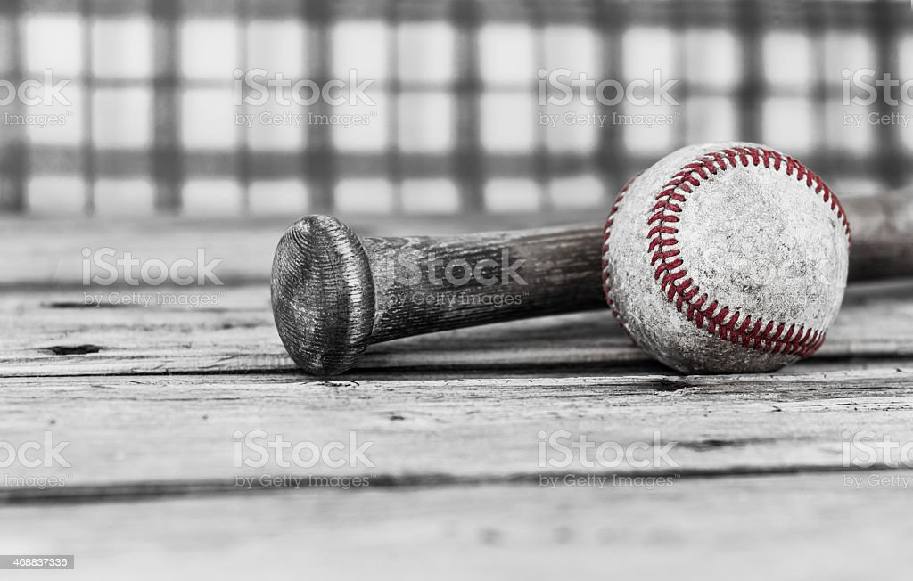 black and white close up image of baseball and bat stock photo