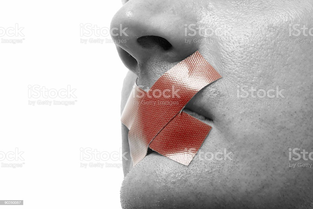 Black and white close-up face with red X taped over mouth stock photo