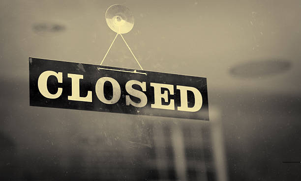 black and white closeup of a closed sign hanging on a window - closed stock photos and pictures