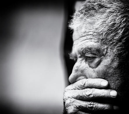 Old man with hand on chin