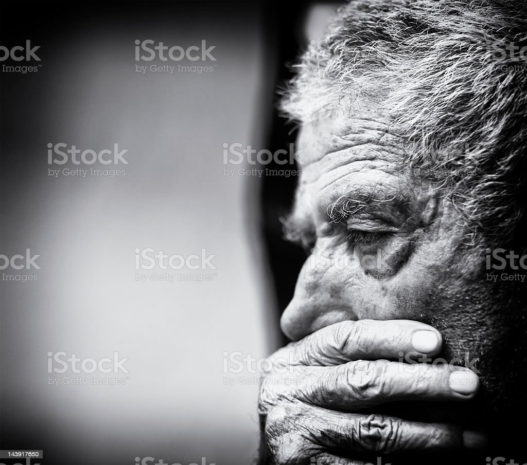 A black and white close-up of a senior man stock photo