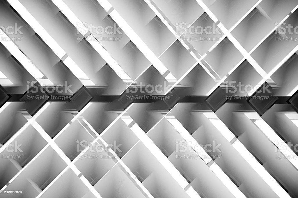 Black and white close-up photo of brightly lit lath ceiling stock photo