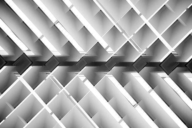 Black and white close-up photo of brightly lit lath ceiling – zdjęcie