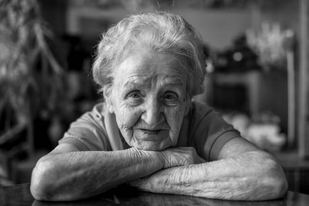 Black and white close-up portrait of an elderly lady. stock photo