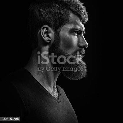 istock Black and white close-up portrait of young handsome bearded man 962156756