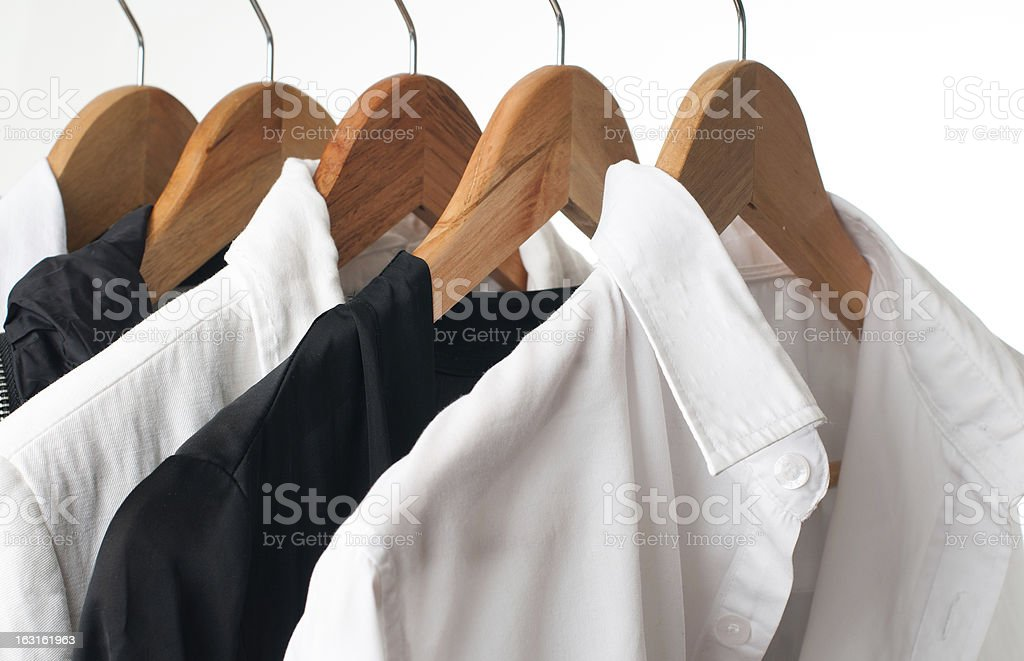 Black and white clothes on a rack, close-up royalty-free stock photo