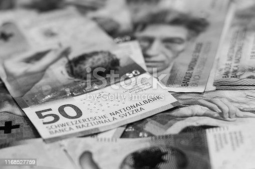 istock Black and white color background with Switzerland currency,money.Focus on number 50 on banknotes 1168527759
