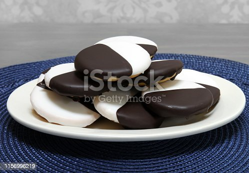 Black and white cookies stacked on an oval plate.  Macro, close up with copy space.