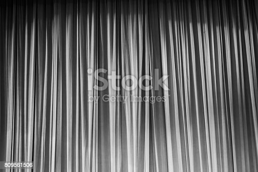 istock Black and white curtains and light. 809561506