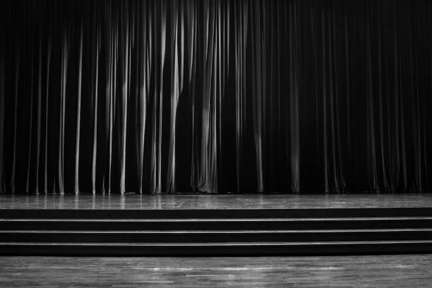 Black and white curtains and wooden stage. stock photo