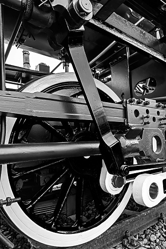 Old german steam locomotive, built in 1940, in a museu. The heaviest locomotive, 85 tons, that circulated in Romania during the Second World War. Detail and close up of huge wheels. B & W processing.