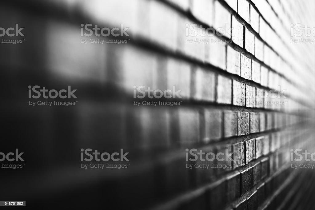 Black and white diagonal brick wall background stock photo