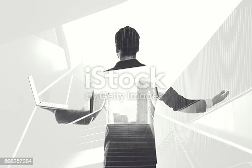 istock black and white double exposure businessman lines 866257264