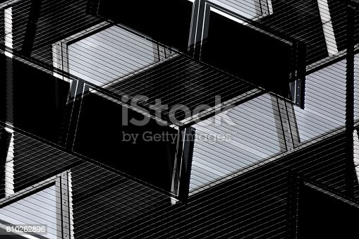 istock Black and white double exposure photo of industrial building fragment 610262896