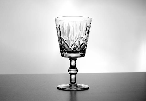 Black and white empty vintage crystal wine glass stock photo