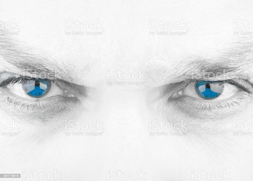 Black and White Evil Stare with Isolated Blue Eyes stock photo