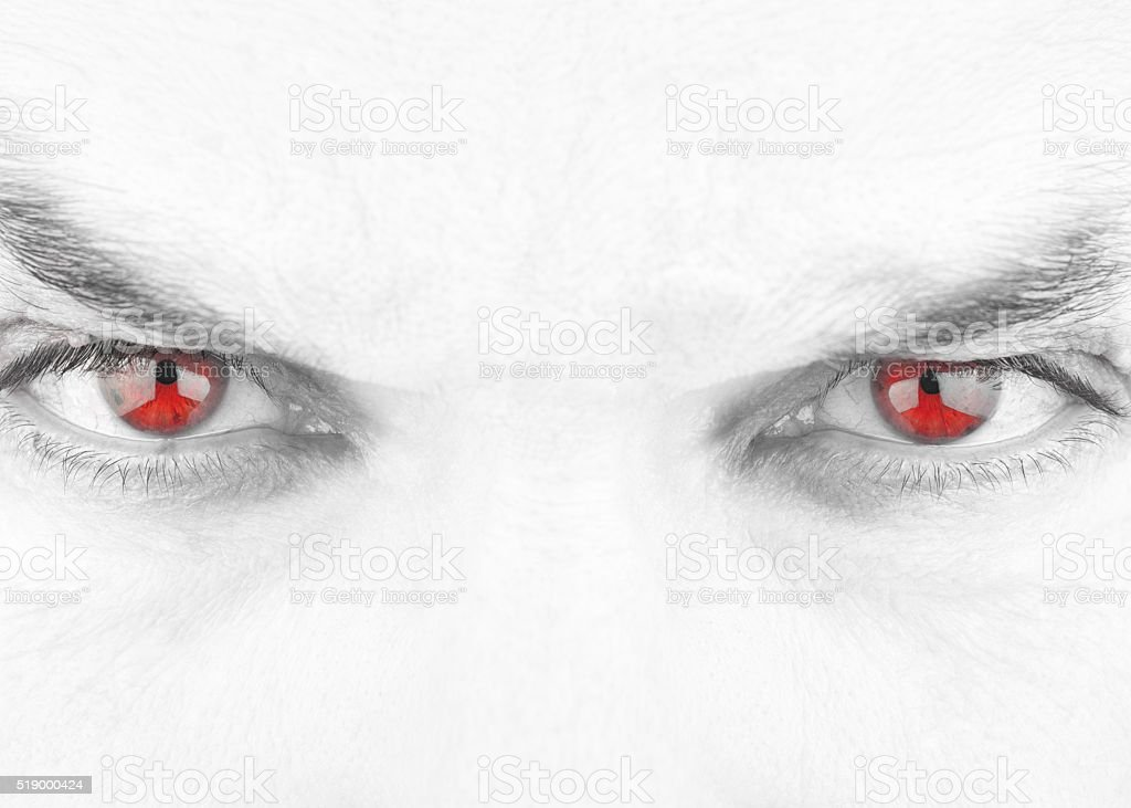 Black and White Evil Stare with Isolated Red Eyes stock photo