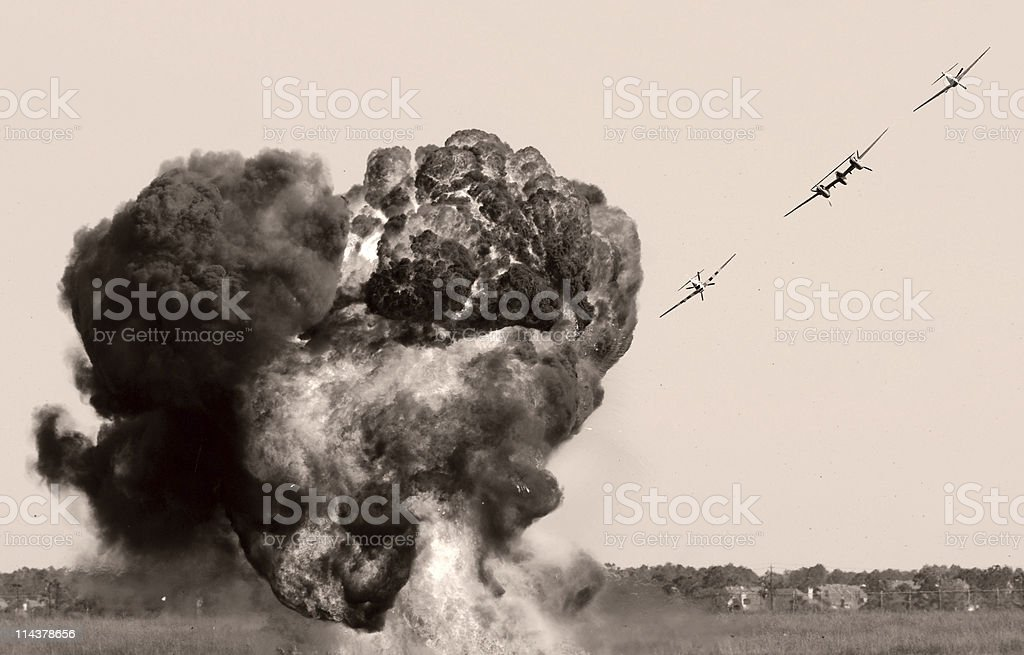 Black and white explosion from aerial assault stock photo