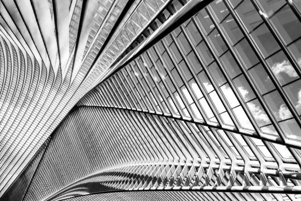 Black and white exposure of modern metal and glass roof construction stock photo