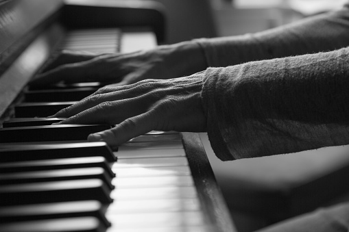 Black and white female playing piano