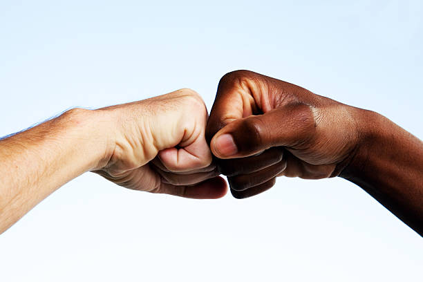 Black and white fists touching  dignity stock pictures, royalty-free photos & images