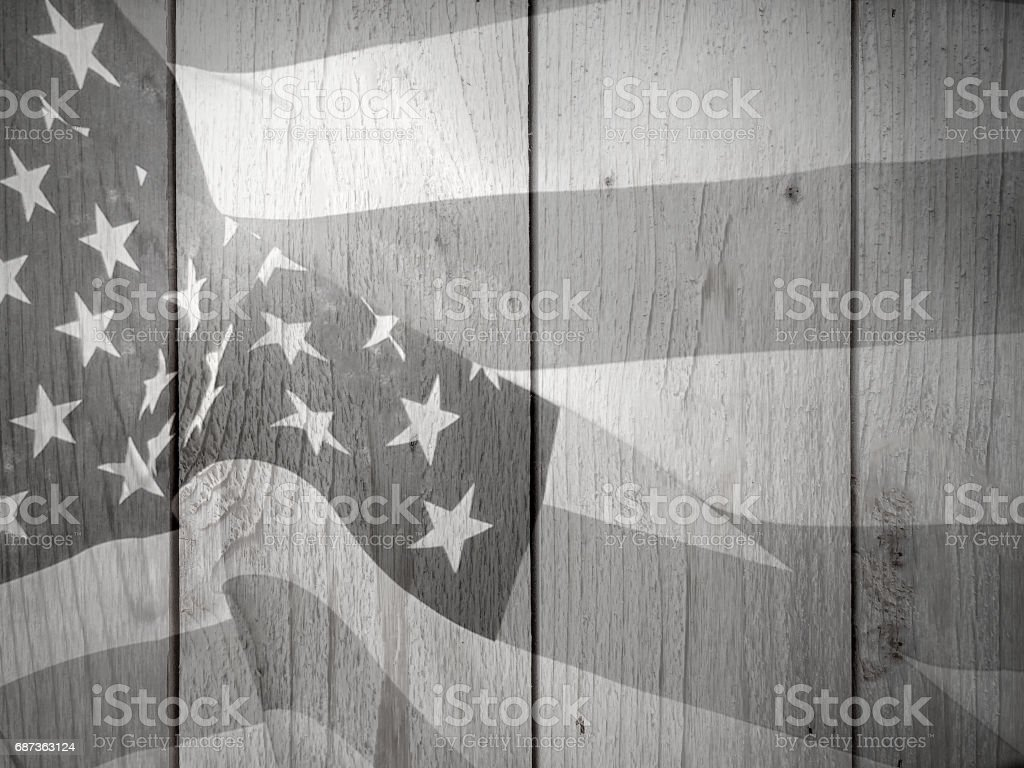 Black and White Flag Over Wood stock photo