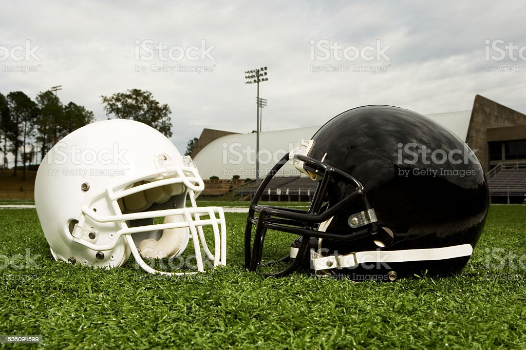 Black and white football helmets stock photo