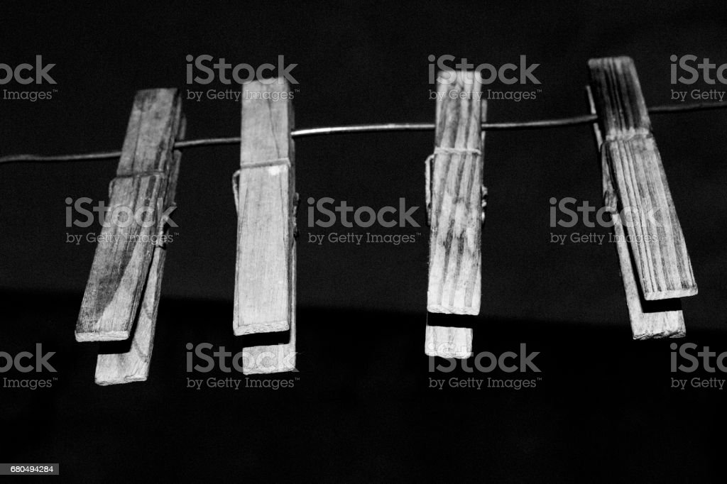 black and white four clothespin stock photo