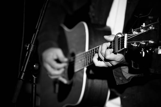 Black and White guitar playing. stock photo