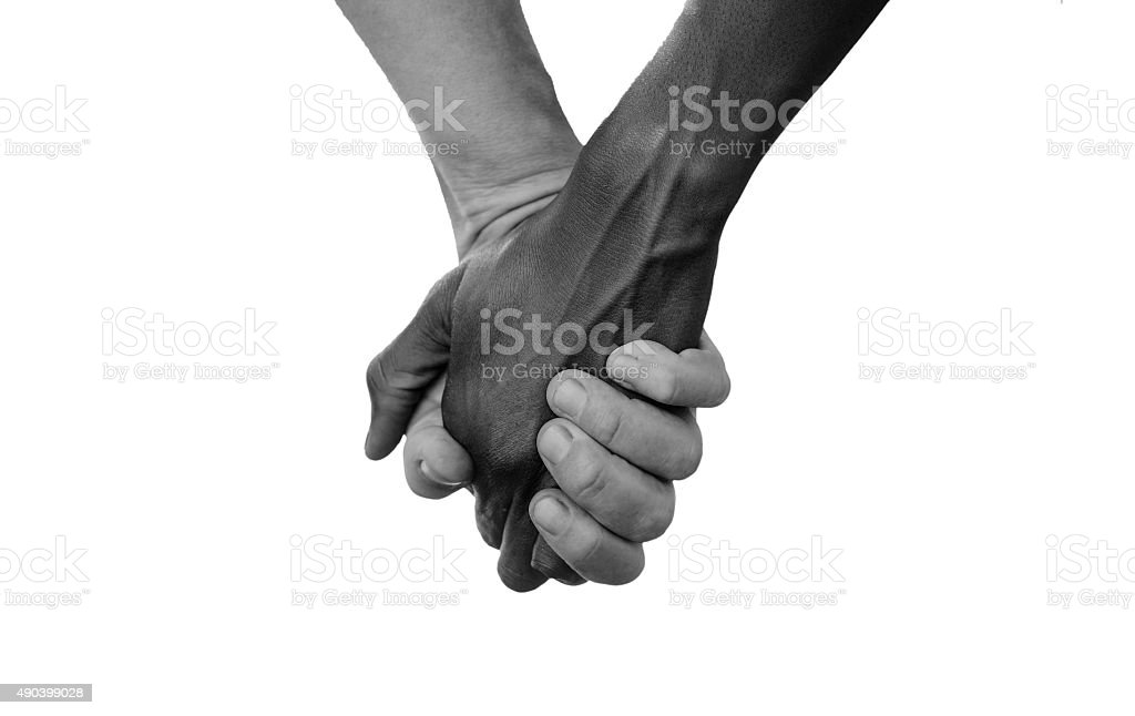 Black and White Hold Hands for Africa Union Peace Love stock photo