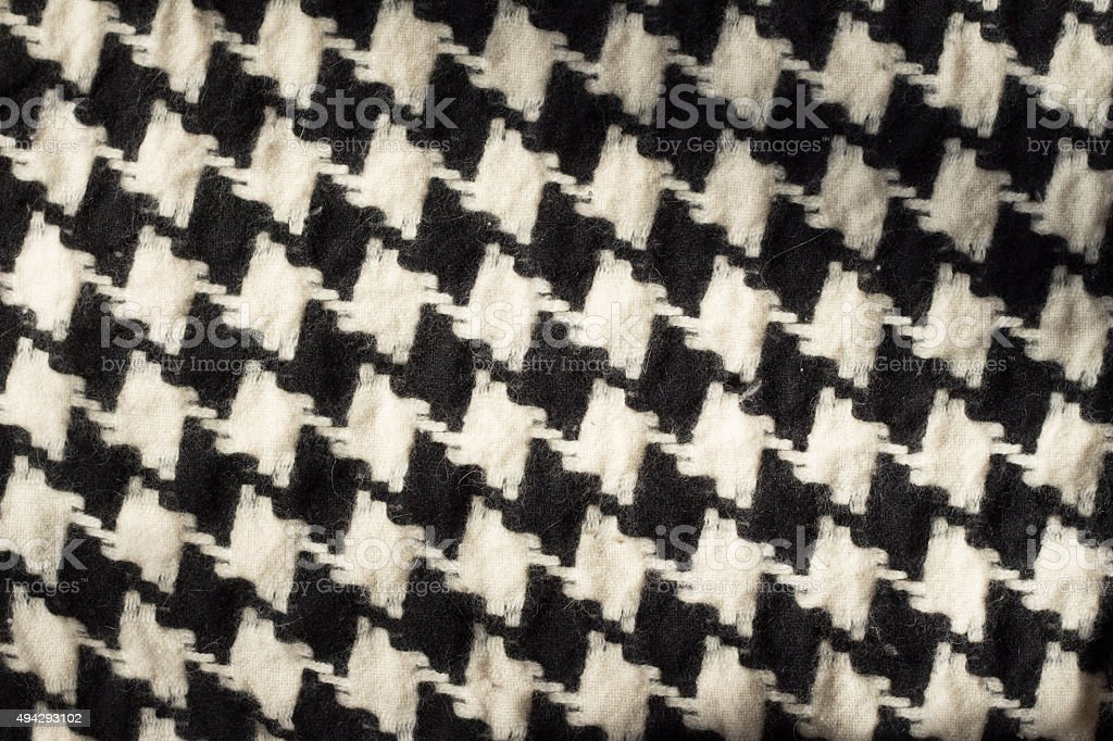 Black and white houndstooth checked design fabric stock photo