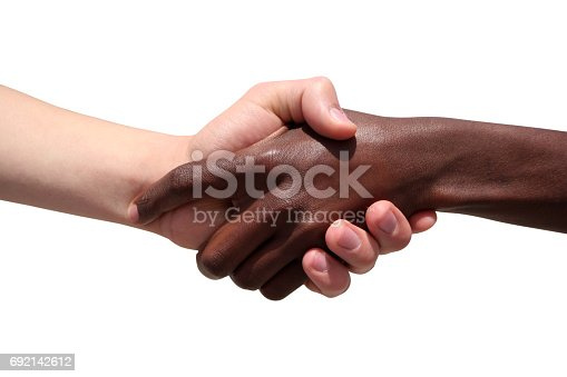 istock Black and white human hands 692142612