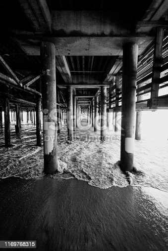 Black and white iew of the pylons of Santa Monica pier in Los Angeles USA