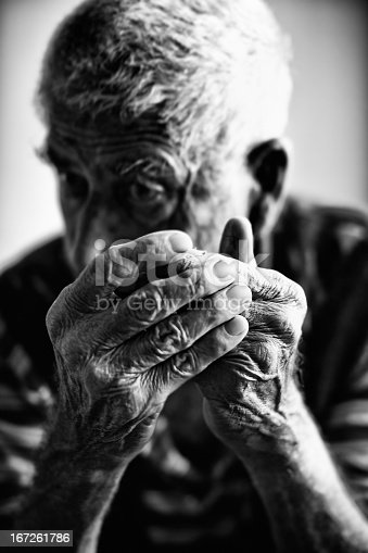 istock Black and white image of a senior man reacting to bad news 167261786