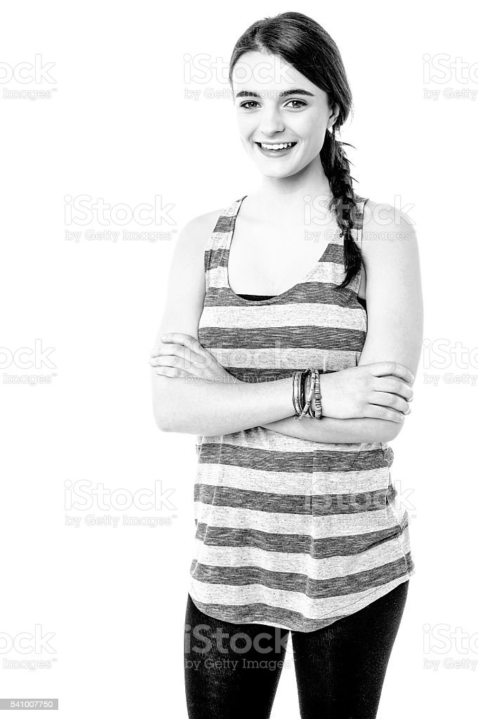 Black and white image of a smiling teenager stock photo