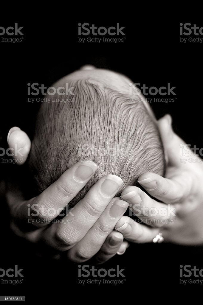 Black and White Image of Baby Safe In Mother's  Hands royalty-free stock photo
