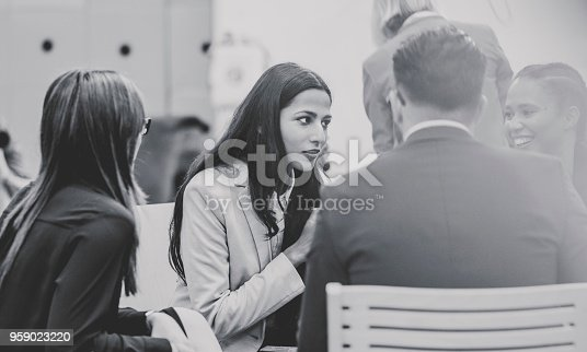 Black and white image of business people in the meeting.
