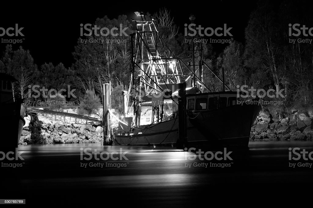 Black and white image of fishing trawler stock photo