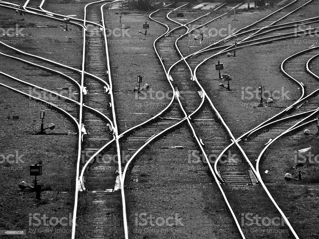 A black and white image of multiple train tracks stock photo