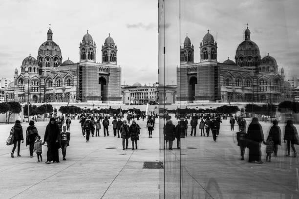 Black and white image of the Marseille Cathedral mirrored in the glass walls, France stock photo