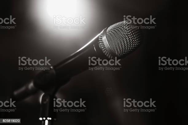 Black and white image of the microphone the microphone on the stage picture id825819020?b=1&k=6&m=825819020&s=612x612&h= qghuf64dq9yr5lv8ltkpxrvwrnvwbvsunyi c6p6ku=