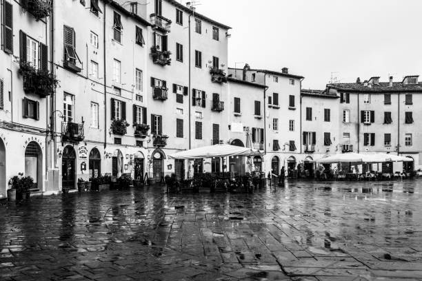 Black and white image of the Piazza dell'Anfiteatro in Lucca, Tuscany, Italy stock photo