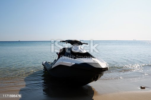 Black and white Jetski for rent parked on the beach in holiday season.