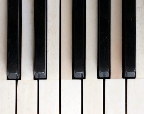 black and white keys on old ivory keyboard of grand piano