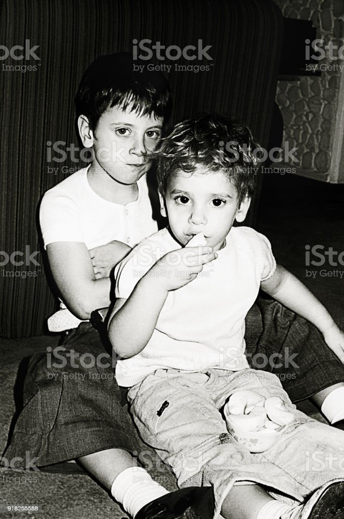 Black and white kids eating snacks stock photo
