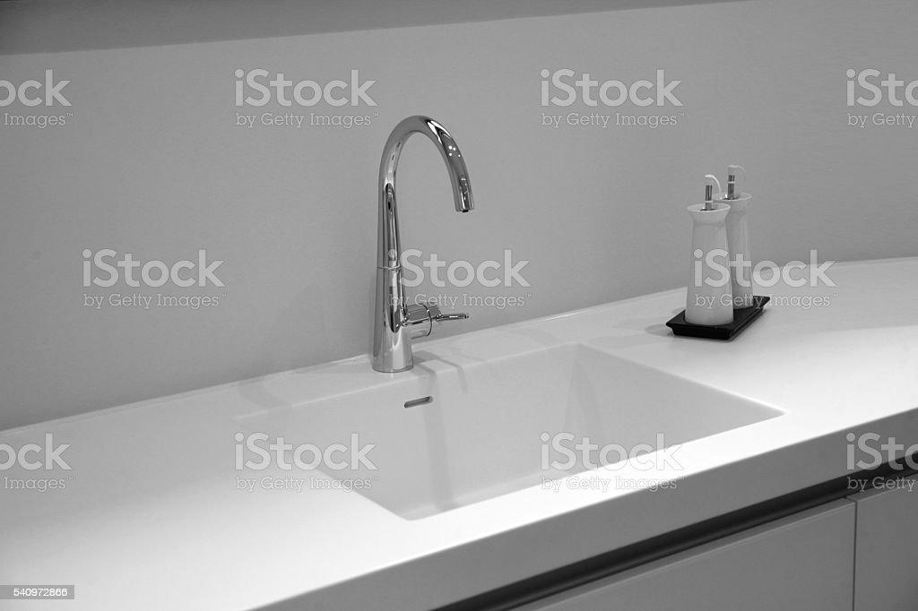 Black and white kitchen sink stock photo