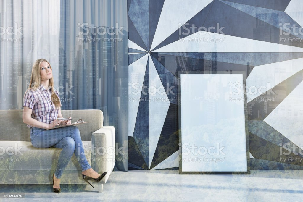 Black and white living room with a poster, woman royalty-free stock photo