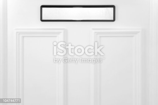 istock Black and white mail slot on a white door 104744771